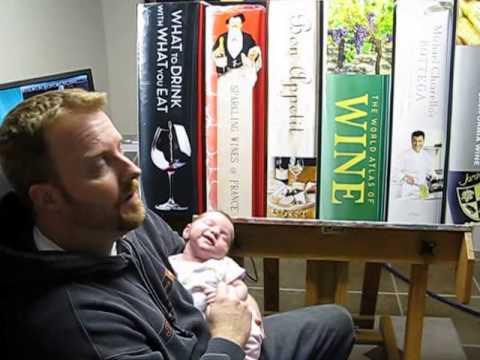 John-Mark Gleadow in his art studio with his child